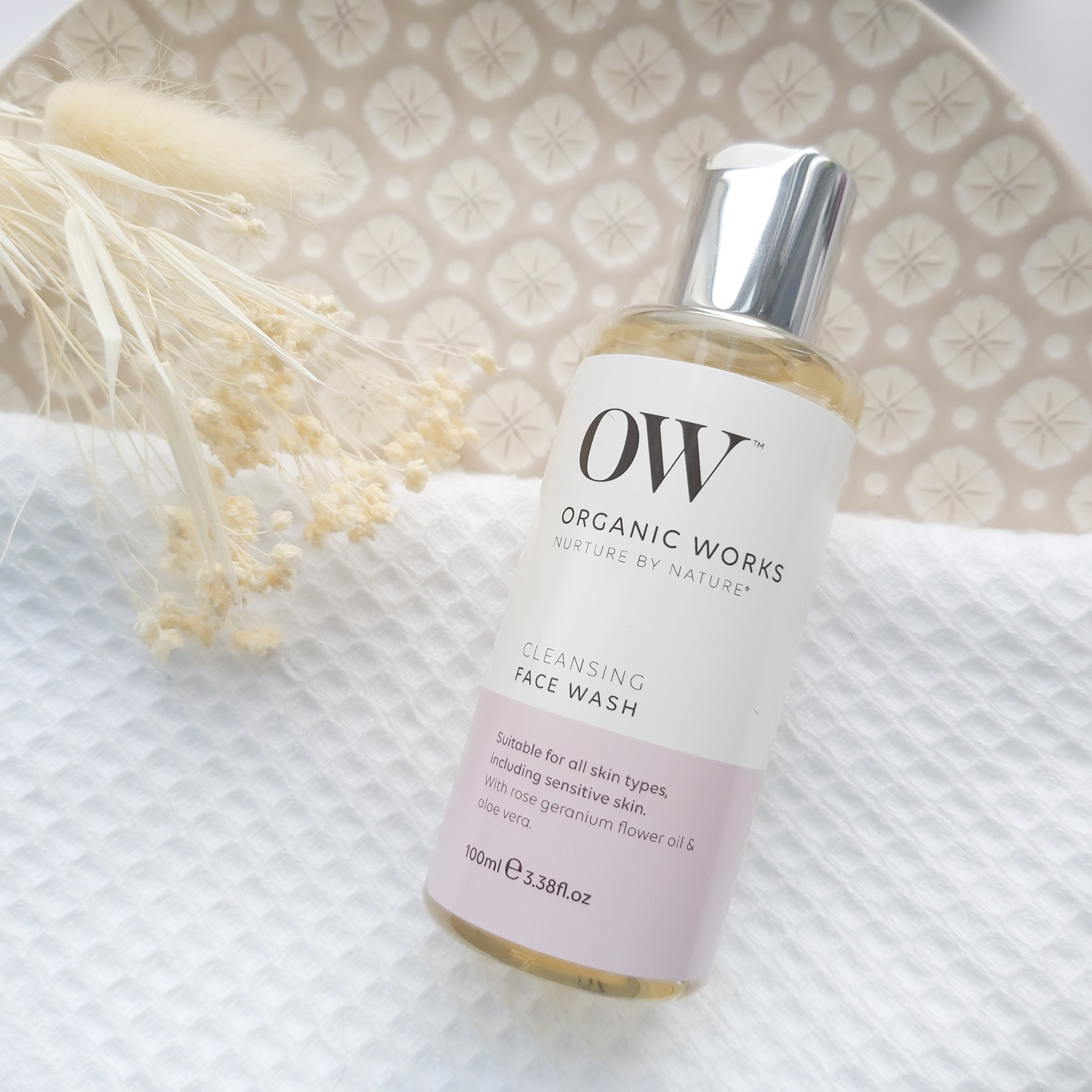 Organic Works Cleansing Face Wash featured in The Natural Beauty Box May 2021 on a patterned plate, waffle white towel and natural foliage - Review by Beauty Folio