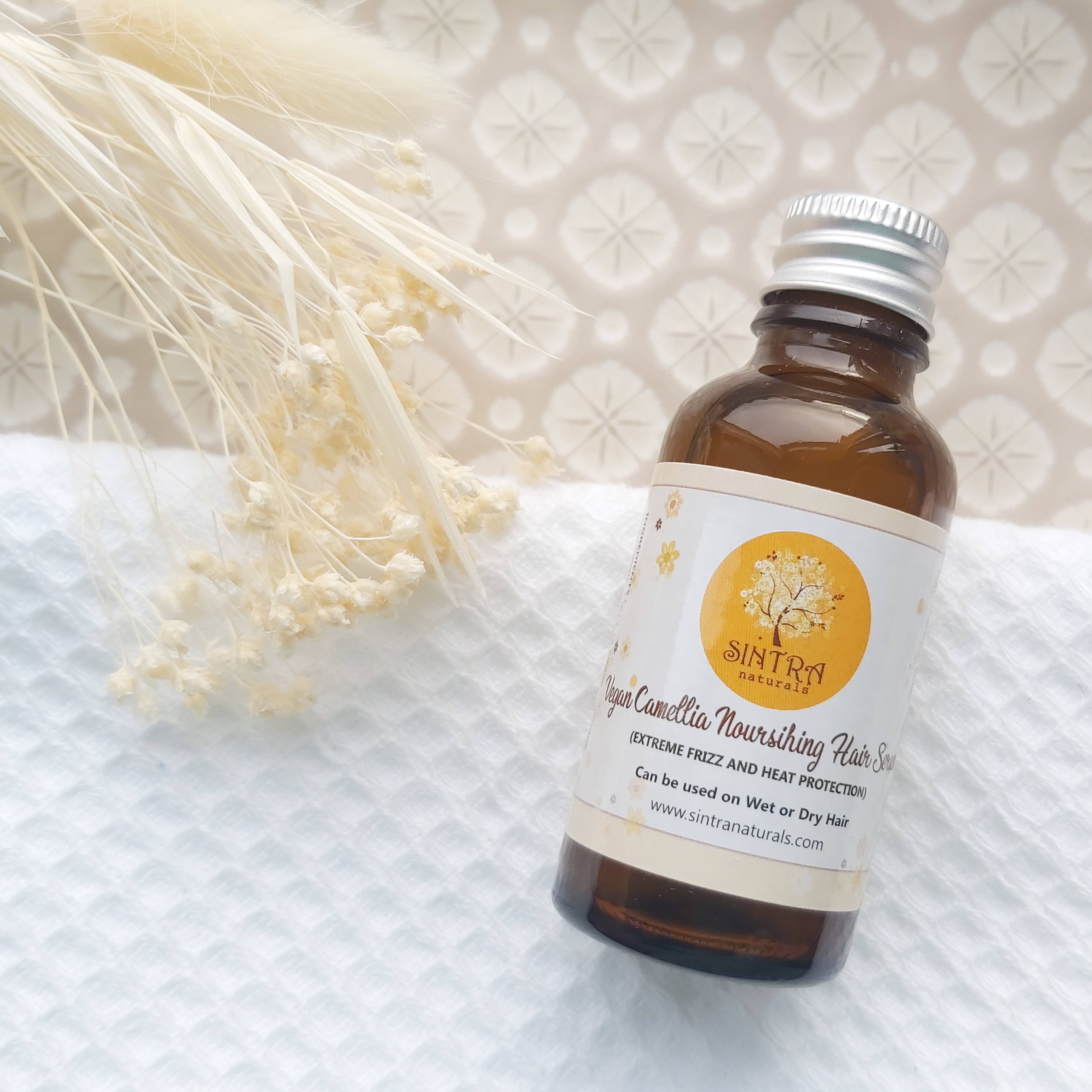 Sintra Naturals Vegan Camellia Nourishing Hair Serem featured in The Natural Beauty Box May 2021 on a patterned plate, waffle white towel and natural foliage - Review by Beauty Folio