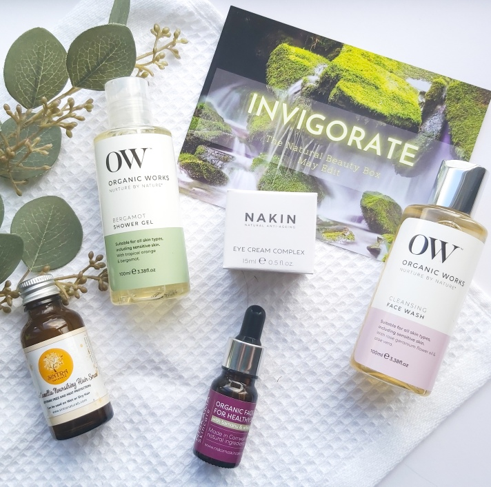 Products featured in The Natural Beauty Box May 2021 on a waffle white towel, green foilage and information card - Review by Beauty Folio