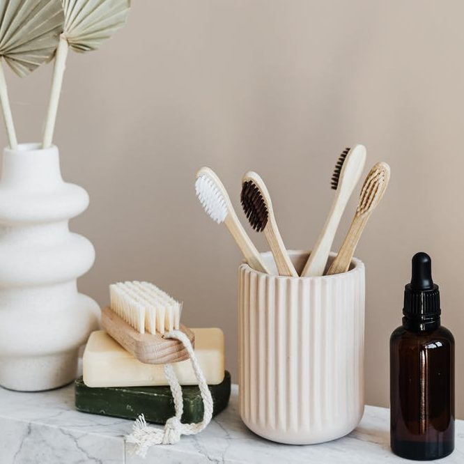 Plastic free beauty items on a marble sideboard. A Plastic Free Green Beauty Guide by Beauty Folio highlighting plastic pollution and plastic free beauty from Lovethical.