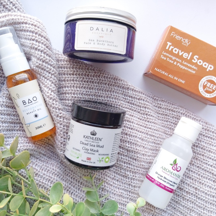 The Natural Beauty Box Replenish Box items with autumn leaves and knitted throw - September Beauty Box - Review by Beauty Folio
