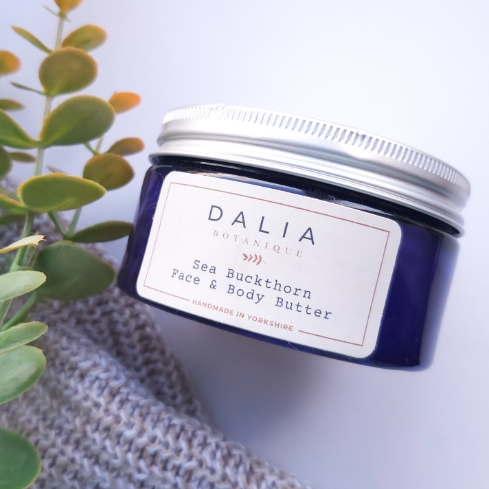 The Natural Beauty Box Replenish Box Dahlia Botanique Sea Buckthorn Face and Body Butter Jar with autumn leaves and knitted throw - September Beauty Box - Review by Beauty Folio